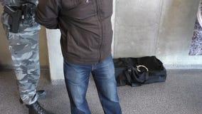 Armed policeman arresting man stock video footage