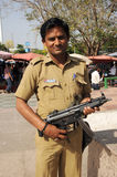 Armed policeman. New Delhi, India. Royalty Free Stock Photo
