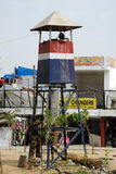 Armed policeman in a tower police post. India. Royalty Free Stock Photo