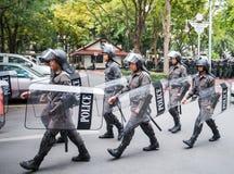 Armed policemen patrol Stock Photos