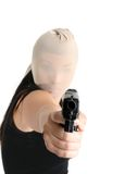 Armed robbery. An armed gunman demands some cash in a robbery stock images