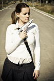 Armed scholar. Young girl portrait with gun Stock Photography