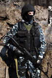 Armed soldier. Armed officer in full ammunition with automatic russian rifle AK47 royalty free stock image