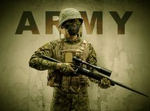 Armed soldier with damaged wall background royalty free stock photography