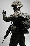 Armed soldier giving hand signal. And directions Royalty Free Stock Photo