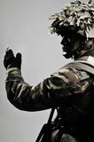 Armed soldier giving hand signal. And directions Royalty Free Stock Photos