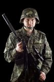 Armed soldier grasping m16 Royalty Free Stock Images