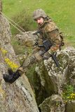 Armed soldier hanging on the rope Royalty Free Stock Images