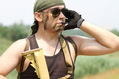 Armed soldier in a headset talking Royalty Free Stock Photography