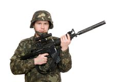 Soldier holding m16. Armed soldier holding m16 in studio. Isolated Stock Photography