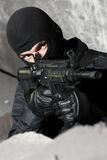 Armed soldier with M-4 rifle. SWAT member targeting with automatic american M-4 gun Royalty Free Stock Photos