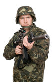 Armed soldier pointing m16. Upperhalf Royalty Free Stock Photography