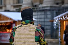 Armed soldier protects Christmas Market in Brussels. BRUSSELS, BELGIUM-DECEMBER 1, 2015: Armed soldier protects Christmas Market in center of Brussels Stock Images