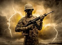 Armed soldier standing in an obscure weather royalty free stock photo
