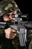 Armed soldier taking aim Stock Photography