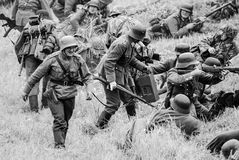 Armed soldiers and battlefield black and white Stock Photos