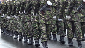 Armed Soldiers. Determined soldiers with their guns, marching along stock video