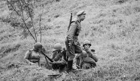 Armed soldiers in trench Royalty Free Stock Photos
