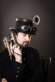 Armed steam punk man Stock Images