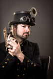 Armed steam punk man Stock Photo