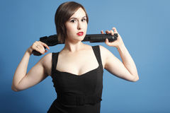 Armed woman in black dress Stock Photography