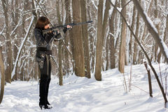 Armed woman in the forest Stock Photography