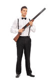 Armed young man holding a shotgun rifle Royalty Free Stock Images