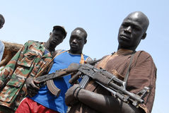 Armed youths. Three armed youths show off their gun in Sudan, Africa Royalty Free Stock Photo