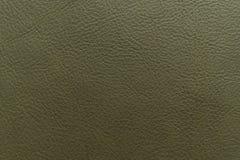 Armee, militärische grüne Farbkörnige, starke Kornkalbkuhlederbeschaffenheit und Hintergrund lizenzfreie stockbilder