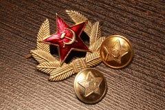 Armee UDSSR Knöpfe und Kokarde stockfotografie
