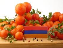 Armeense vlag op een houten die paneel met tomaten op whit wordt geïsoleerd Royalty-vrije Stock Afbeeldingen