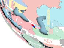 Armenia with flag on globe. Armenia on bright political globe with embedded flag. 3D illustration Stock Image