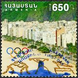 ARMENIA - 2016: shows Copacabana, Olympic Rings, 31th Olympic Games, Rio, Brazil. ARMENIA - CIRCA 2016: A stamp printed in Armenia shows Copacabana, Olympic Royalty Free Stock Image