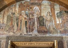 The main entrance to the church of Saint Gayane. Armenia, Echmiadzin. The main entrance to the church of Saint Gayane with a fresco about the Nativity with Stock Image