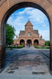 Armenia - Etchmiadzin Vagharshapat - 7th-century church of Saint Gayane taken through the arch of the church fence stock photography