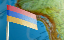 Armenia flag with a globe map as a background Stock Image