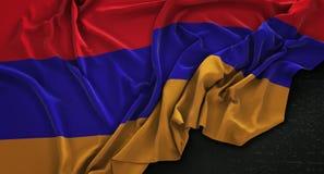 Armenia flaga Marszczył Na Ciemnym tle 3D Odpłaca się Zdjęcie Stock