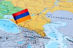 Armenia map and flagpin. Armenia paper flag pin on a country map. officially the Republic of Armenia is a country in the South Caucasus region of Eurasia royalty free stock image