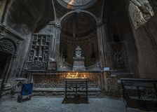 One of the forty altars of the monastery of Geghard. Armenia, the monastery complex of Geghard is called `the monastery of seven churches and forty altars` Royalty Free Stock Photos