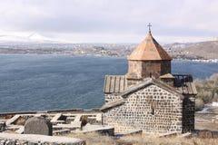 Armenia. Sevan Lake. Surb Arakelots church in winter. View of Surb Arakelots church in winter, Sevanavank orthodox monastery,northwestern shore of Lake Sevan stock photography