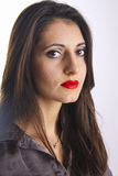 Armenian beauty. Cute young armenian girl with red lips posing in studio royalty free stock photos