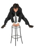 Armenian businessman jumps above  stool. On white Stock Images