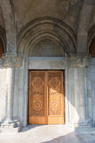 Armenian Church of St. Ripsime in Yalta. Entrance of the church is decorated with carved wooden door. Architectural decorative element. Architectural detail Stock Images