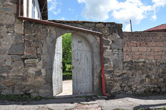 Armenian courtyard. Arch of stone Stock Image