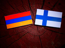 Armenian flag with Finnish flag on a tree stump isolated Royalty Free Stock Image