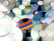 Armenian flag on top of CD and DVD pile isolated on white. Armenian flag on top of CD and DVD pile isolated Stock Image