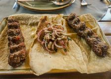 Armenian Kabab and Onions on Bread stock photography