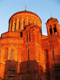Armenian orthodox church in Moscow. Red stone church decorated with carvings in front of blue sky Stock Photo