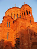 Armenian orthodox church in Moscow. Red stone church decorated with carvings in front of blue sky Royalty Free Stock Photography