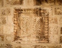 Armenian stone carving, Cathedral of Saint James in Jerusalem, Israel. Armenian khachkar carving, stone carving art on the wall in the courtyard of the Cathedral stock photos